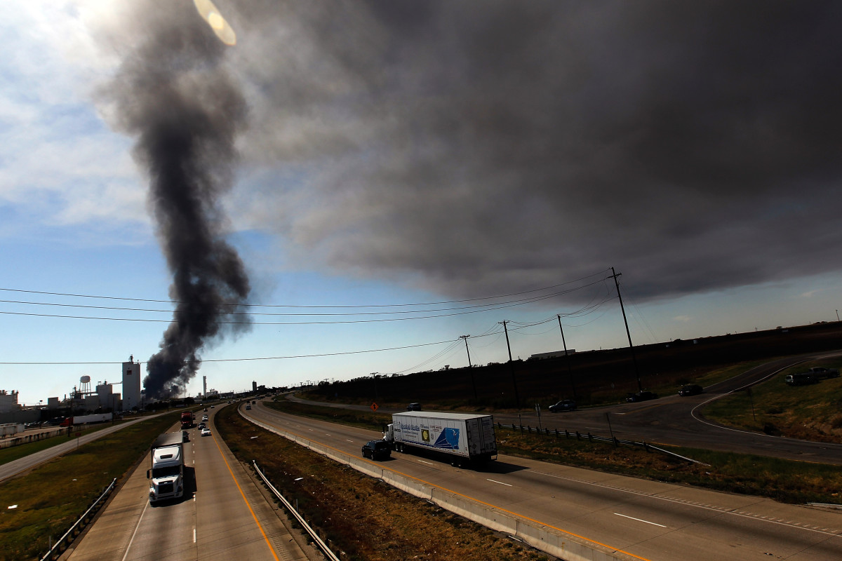 Traffic continues on Interstate 35 as Waxahachie firefighters battle a massive fire at the Magnablend chemical processing plant on October 3rd, 2011, in Waxahachie, Texas.