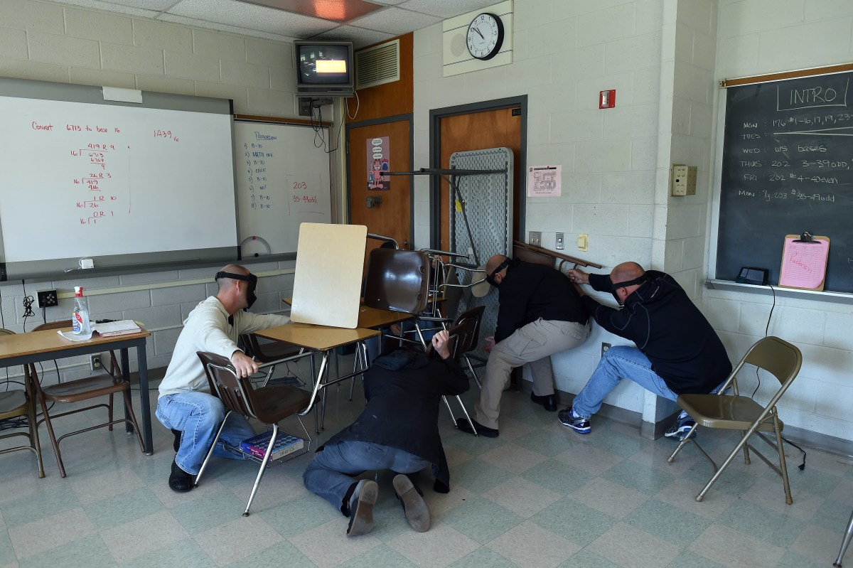 """Students"" barricade a door of a classroom to block an ""active shooter"" during ALICE (Alert, Lockdown, Inform, Counter and Evacuate) training at the Harry S. Truman High School in Levittown, Pennsylvania, on November 3rd, 2015."