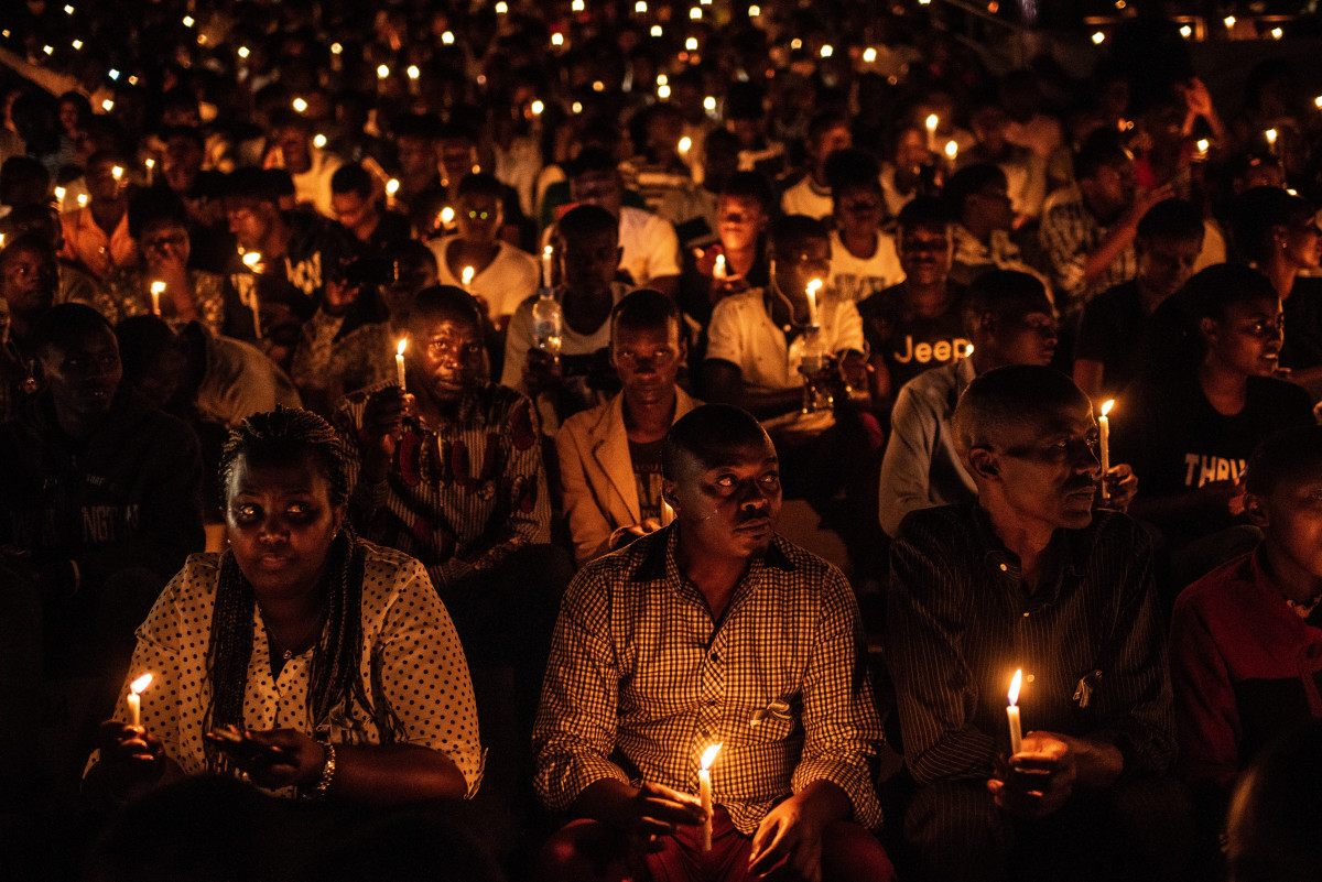 At a commemoration ceremony during the 25th anniversary of the Rwandan genocide, in which 800,000 Tutsis and moderate Hutus were killed over a 100-day period, people hold candles at Amahoro Stadium in Kigali, Rwanda, on April 7th, 2019.