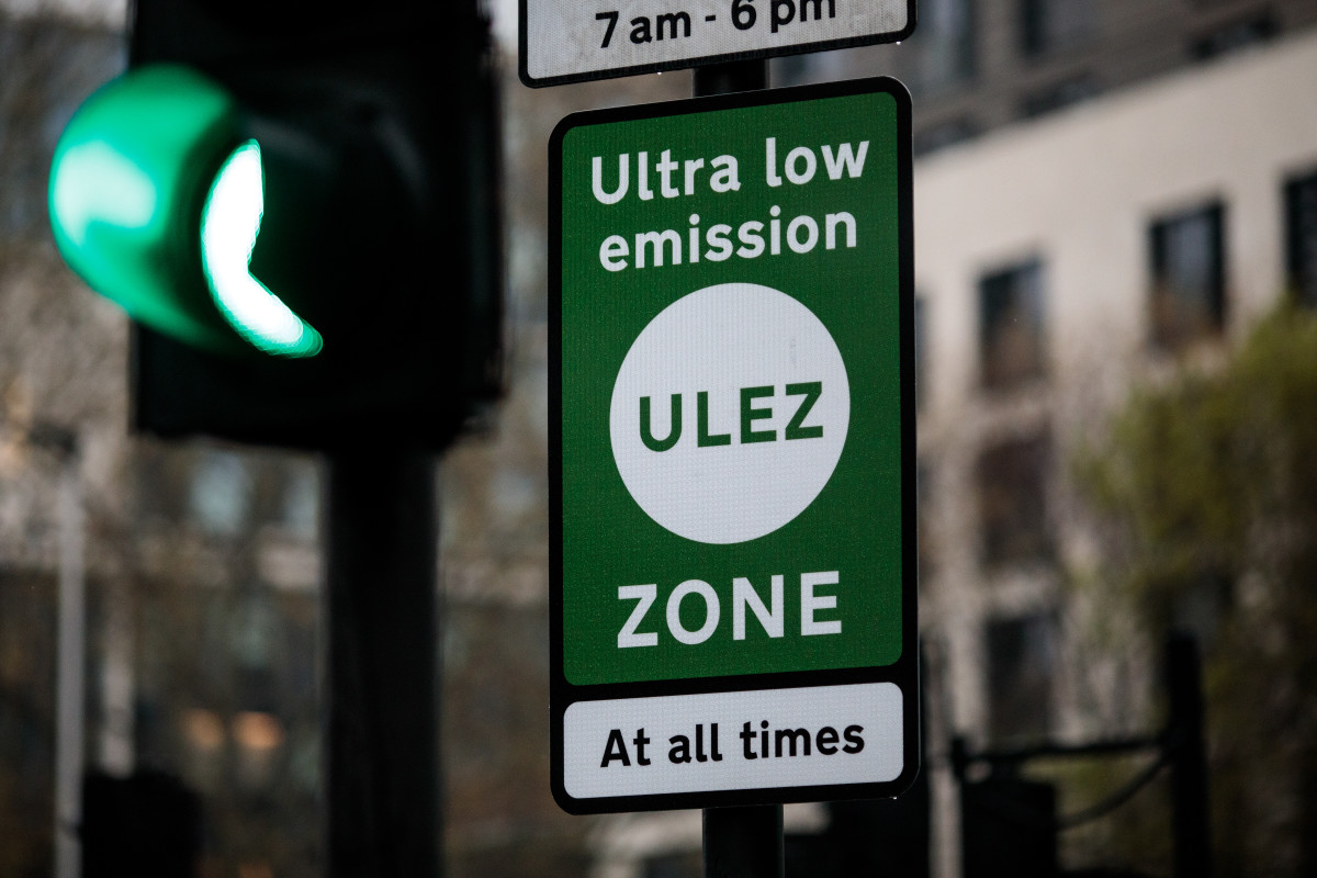 A green sign demarcates London's Ultra Low Emissions Zone as the charge comes into effect on April 8th, 2019, in London, England. In a bid by Transport for London to improve air quality, older and more polluting cars will be charged £12.50 to enter the ULEZ area and congestion zone.