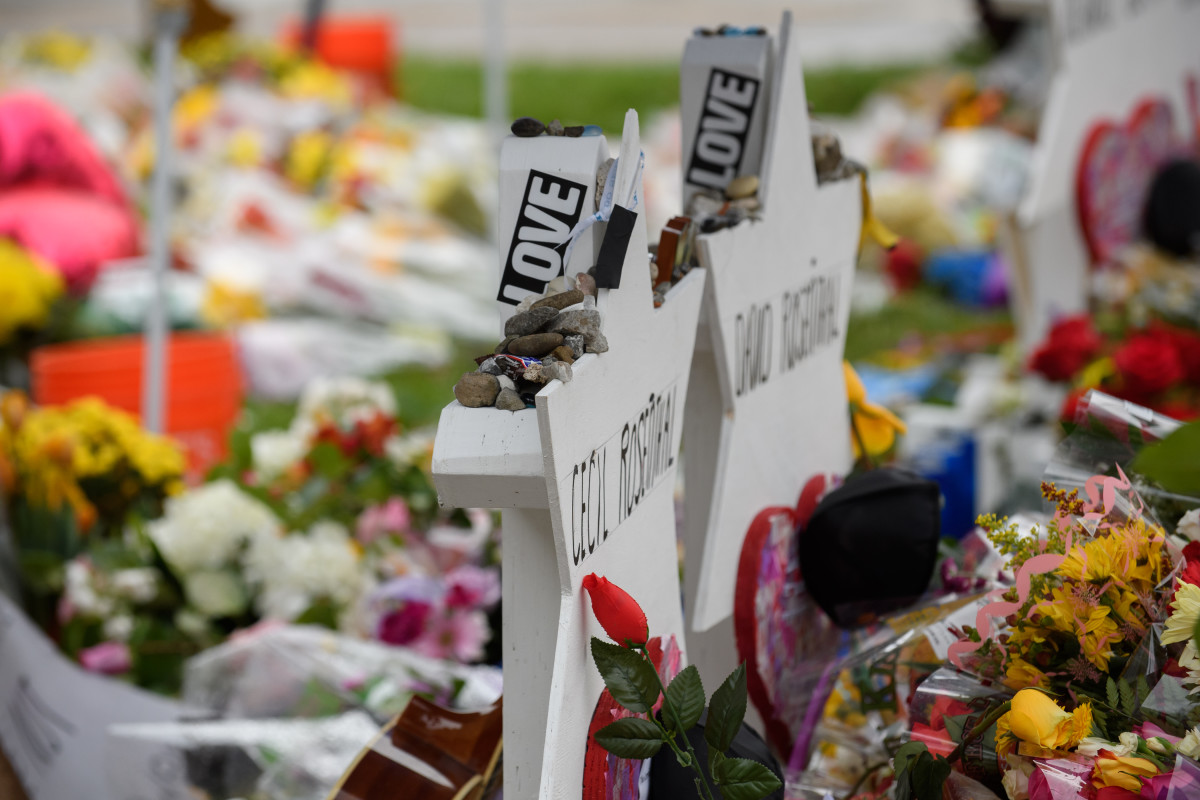 Flowers are laid at a makeshift memorial in front of the Tree of Life Synagogue on November 3rd, 2018, in Pittsburgh, Pennsylvania, following a mass shooting that left 11 of its members dead on October 27th.