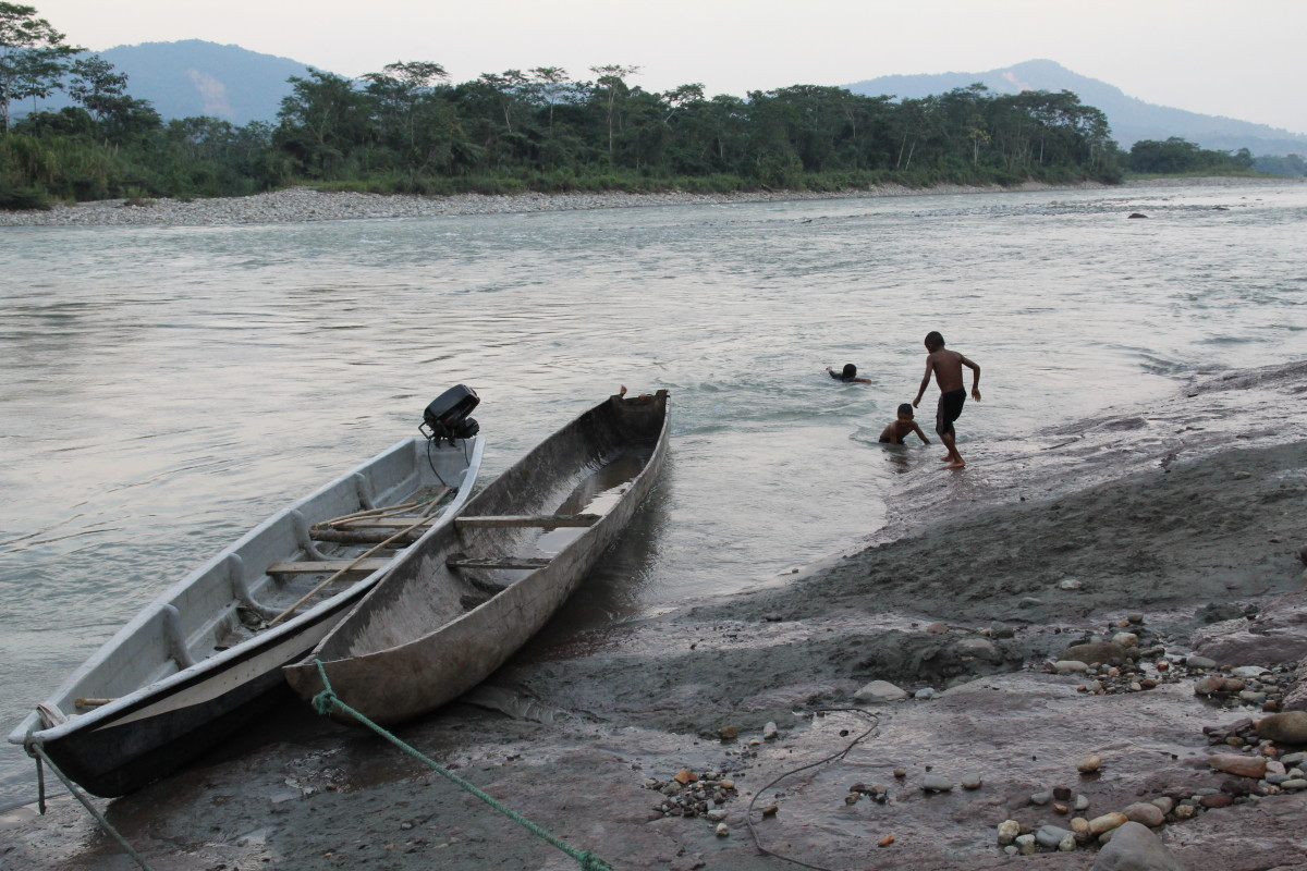 Kids play in the Aguarico river just outside of the community of Sinangoe, Ecuador, downstream from where the Cofan guardia found gold miners operating on the shores of the river.