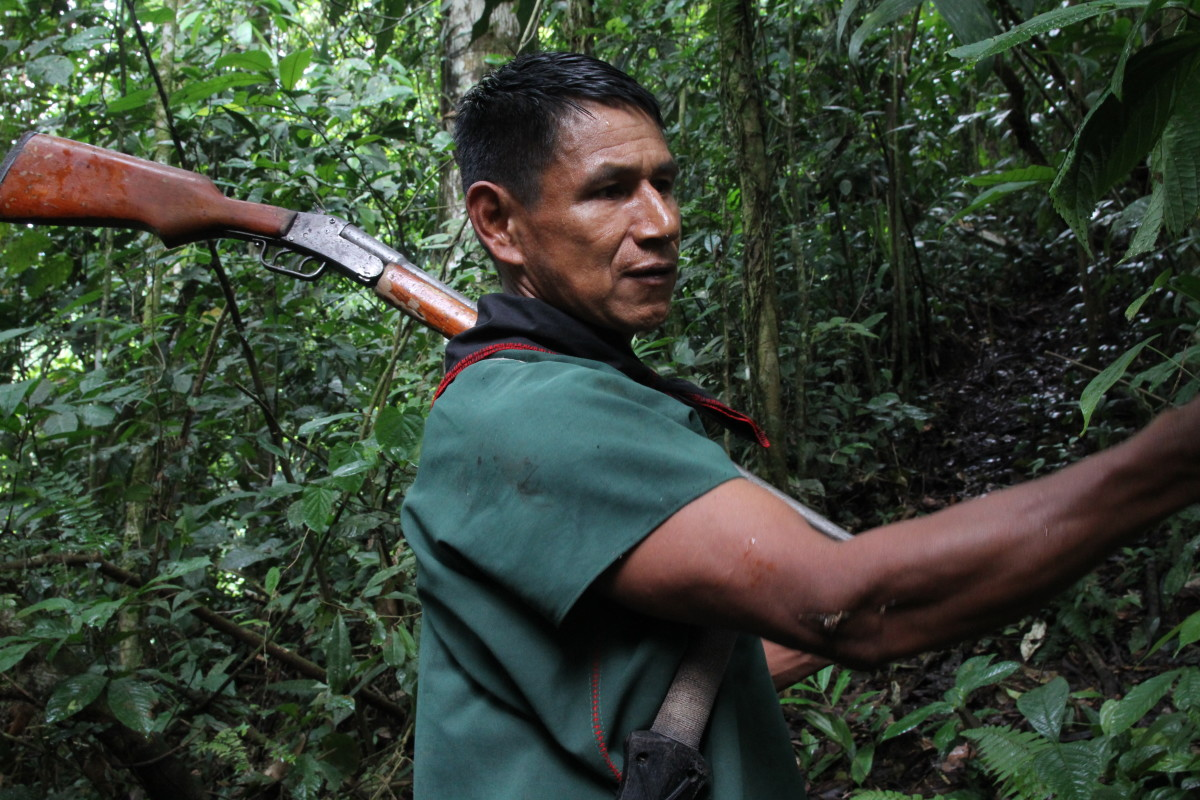 During a trek through the jungle, Viejo stops to point out some sap on a tree that's good for lighting fires.