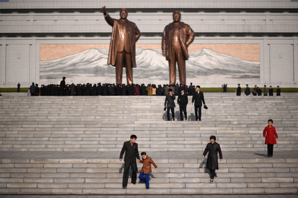 A man and child walk away after paying their respects before the statues of late North Korean leaders Kim Il-sung and Kim Jong-il, as part of celebrations marking the anniversary of the birth of Kim Il-sung, known as the Day of the Sun, on Mansu hill in Pyongyang on April 15th, 2019.