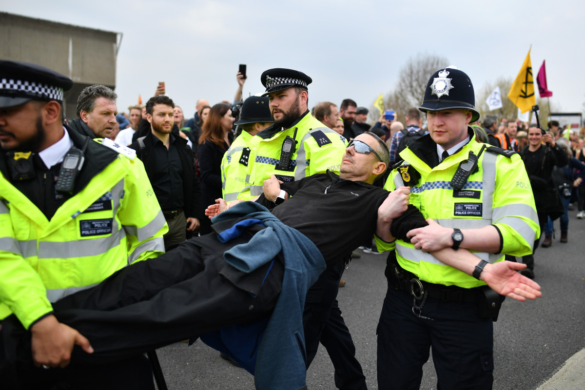 Police officers remove protesters from a blockade on Waterloo Bridge during the second day of a coordinated protest by the Extinction Rebellion group on April 16th, 2019, in London, England. More than 100 arrests have been made, with demonstrations blocking a number of locations across the capital.