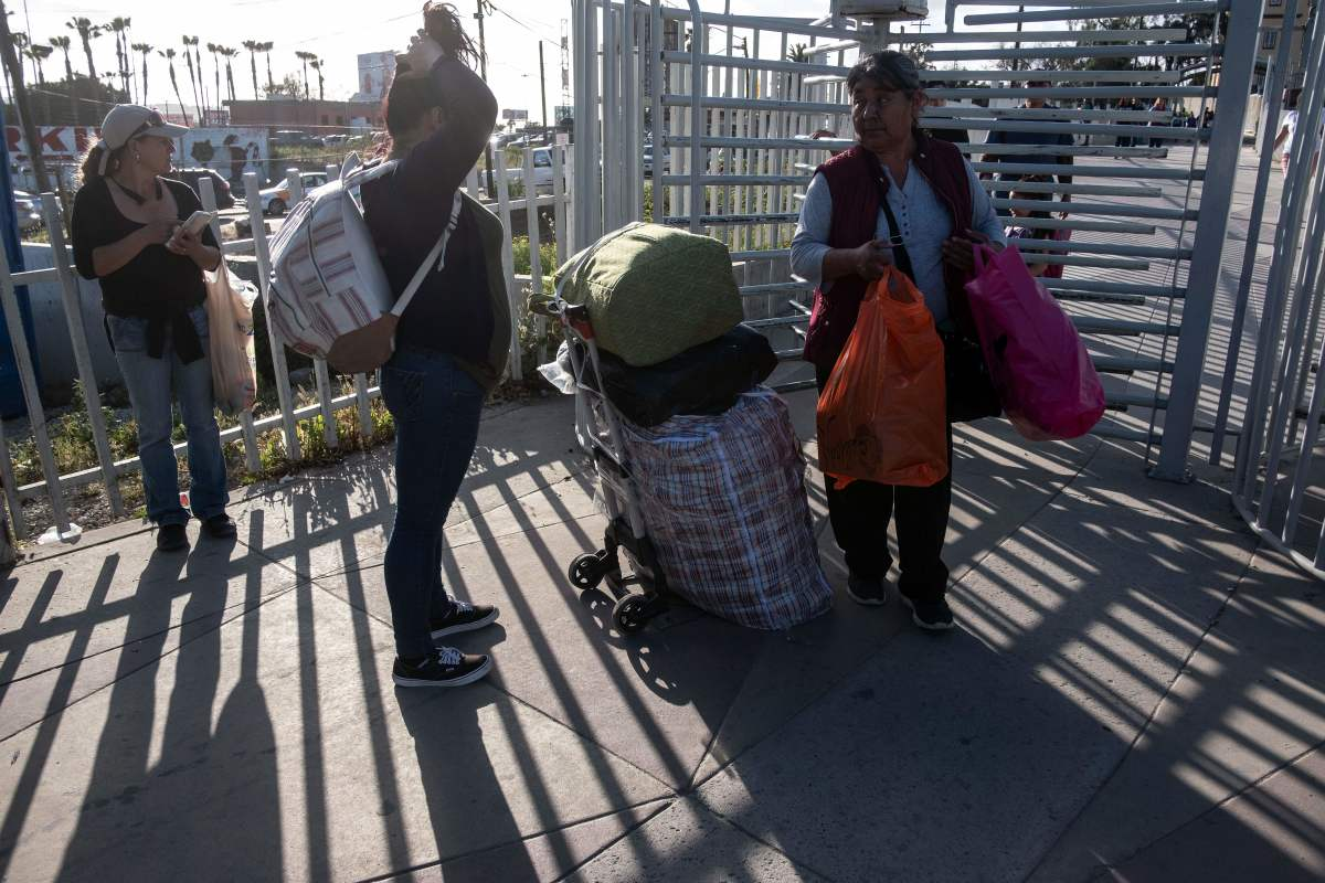 People walk back to Tijuana from San Diego at San Ysidro crossing port in Tijuana, Mexico, on April 2nd, 2019.