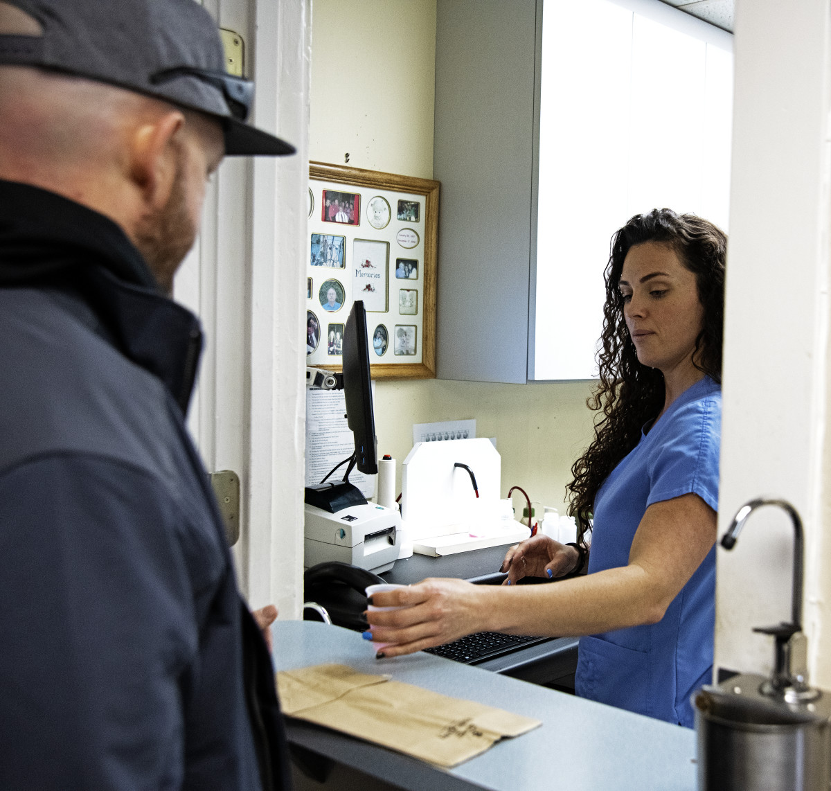 A client receives his dose of methadone from a dispensing nurse at C.O.R.E. Medical Clinic in Sacramento, California, on March 13th, 2019.