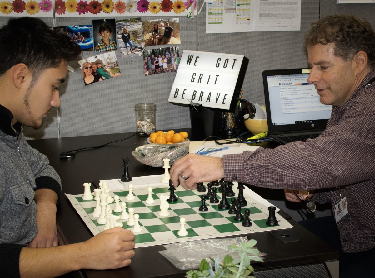 "Jason Wasserman, a teacher, plays chess with an advisee. ""It's all the underdogs,"" he says of students at SAVA."