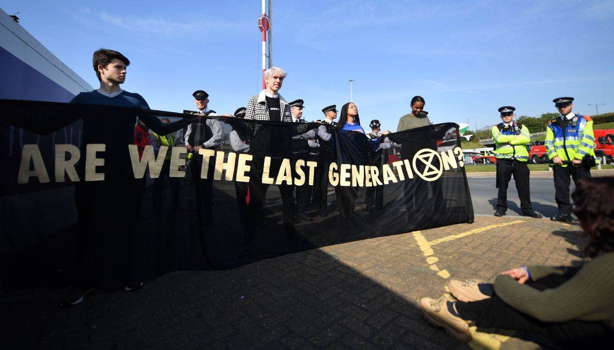 "Young climate change activists hold a banner that reads ""Are we the last generation?"" during a demonstration outside Heathrow Airport in west London on April 19th, 2019, during the fifth day of an environmental protest by the Extinction Rebellion group."
