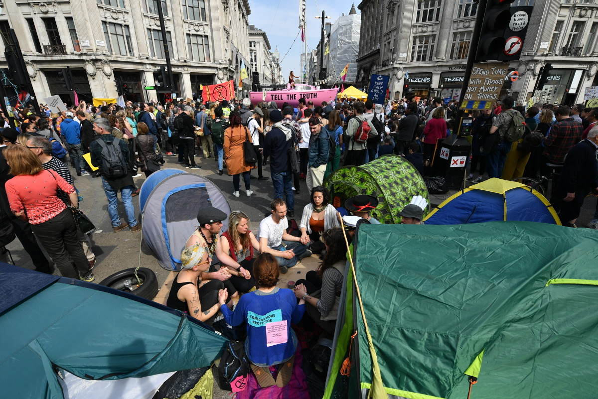 Climate protesters gather around a boat at Oxford Circus during a coordinated protest by the Extinction Rebellion group on April 18th, 2019, in London, England.