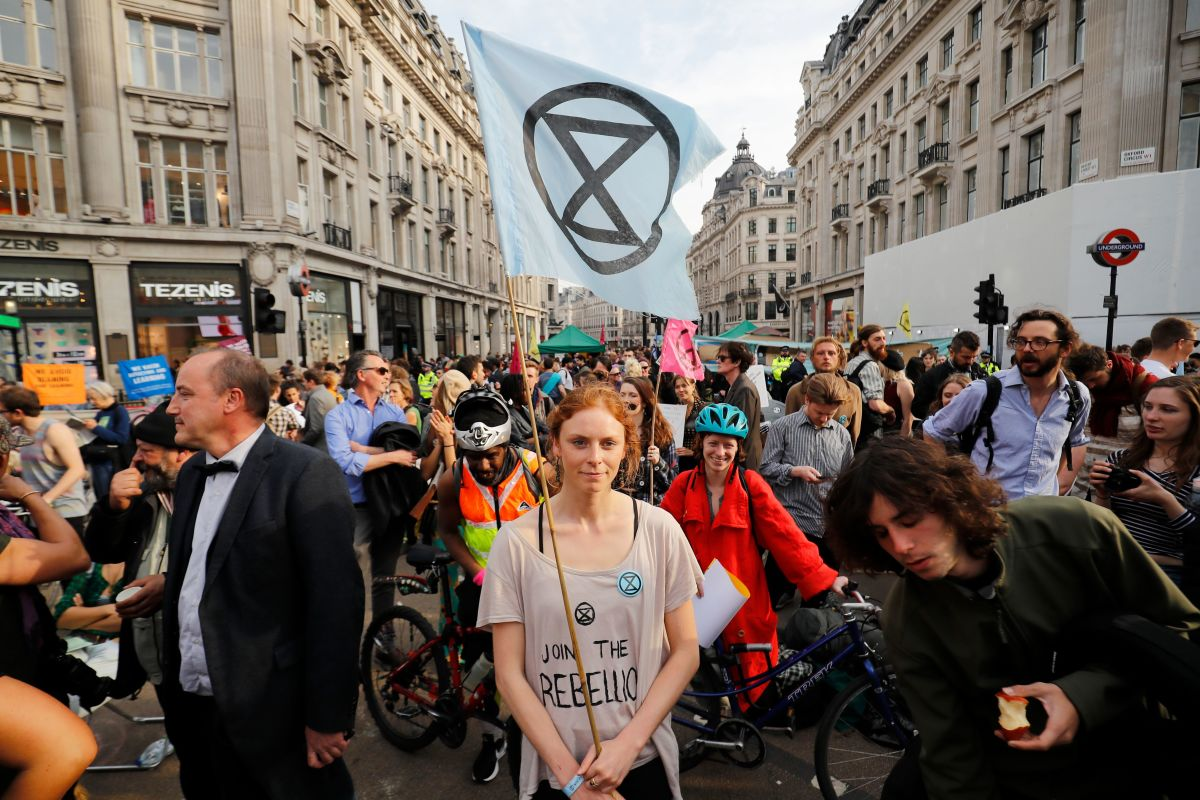 Climate change activists block the road junction at Oxford Circus in central London on April 18th, 2019, during an environmental protest by the Extinction Rebellion group. Climate change activists on Thursday brought parts of the British capital to a standstill on the fourth consecutive day of demonstrations.