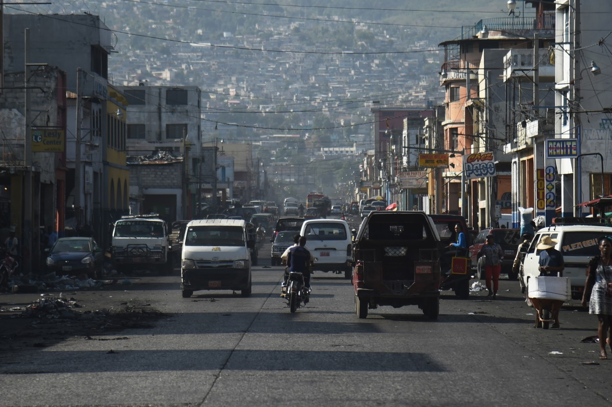 Cars move along a street in the center of the Haitian capital of Port-au-Prince.