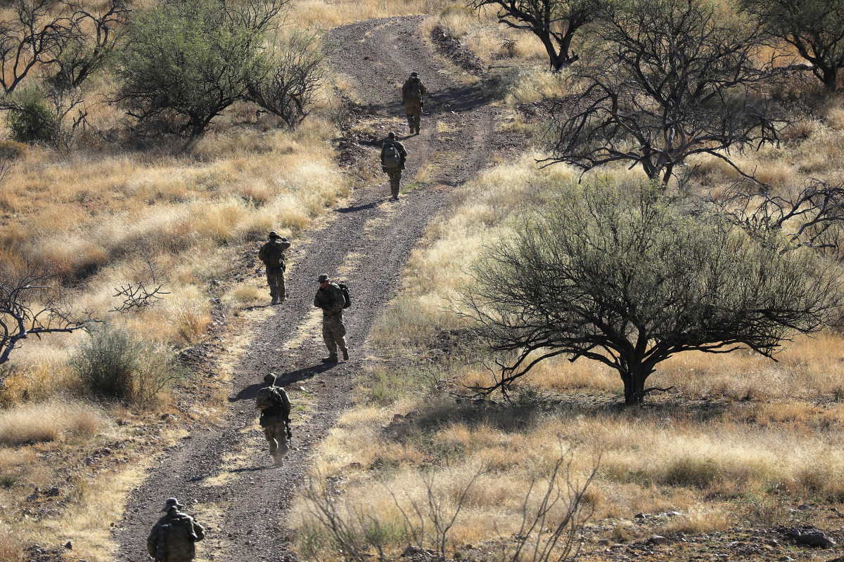 Civilian paramilitaries with Arizona Border Recon search for undocumented immigrants near the U.S.–Mexico border on November 14th, 2016, near Arivaca, Arizona. The armed group, made up mostly of former U.S. military servicemen and women, does not consider itself a militia, but sees itself as supplementing Border Patrol's efforts to control illegal border activity.