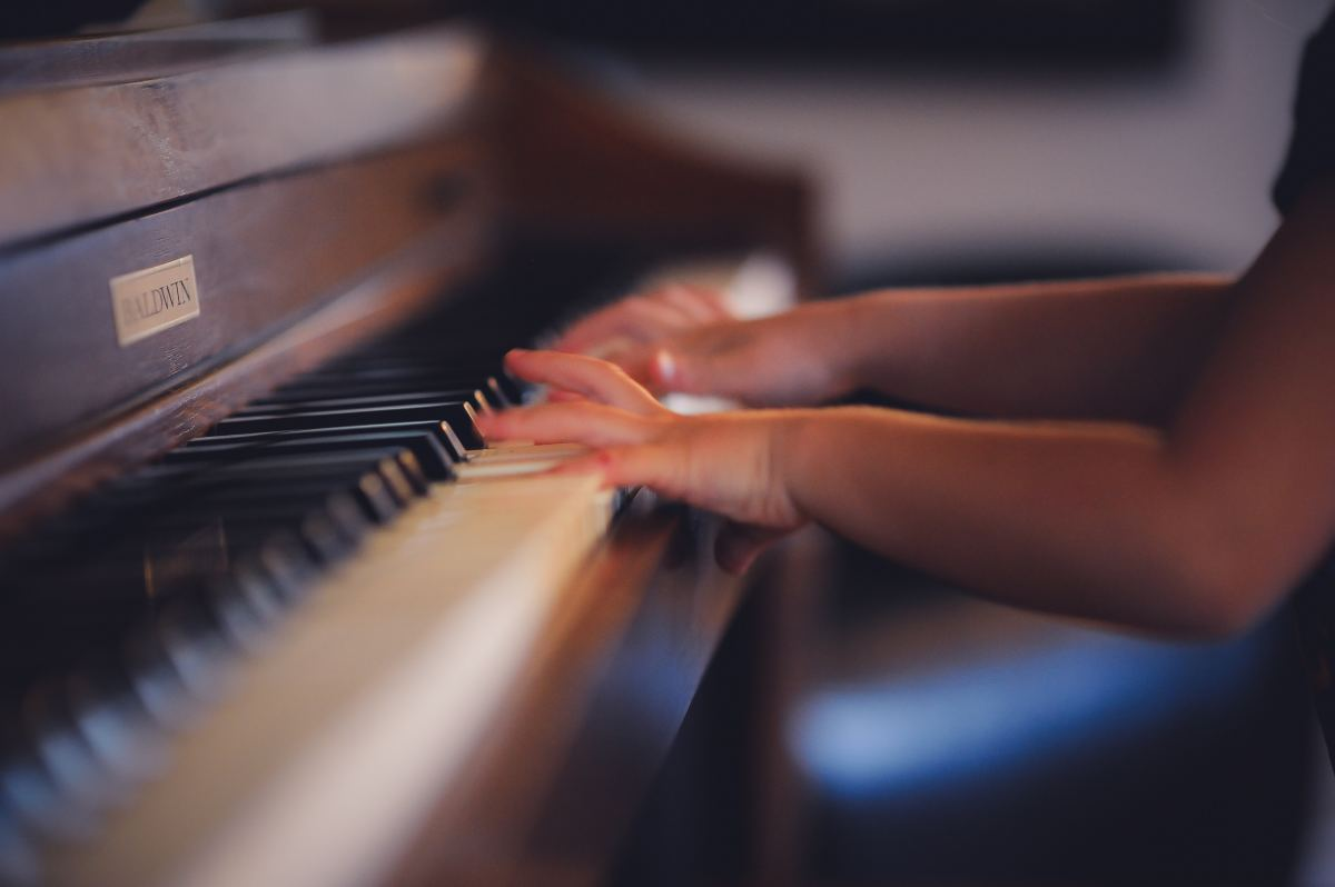 Child playing piano music arts education