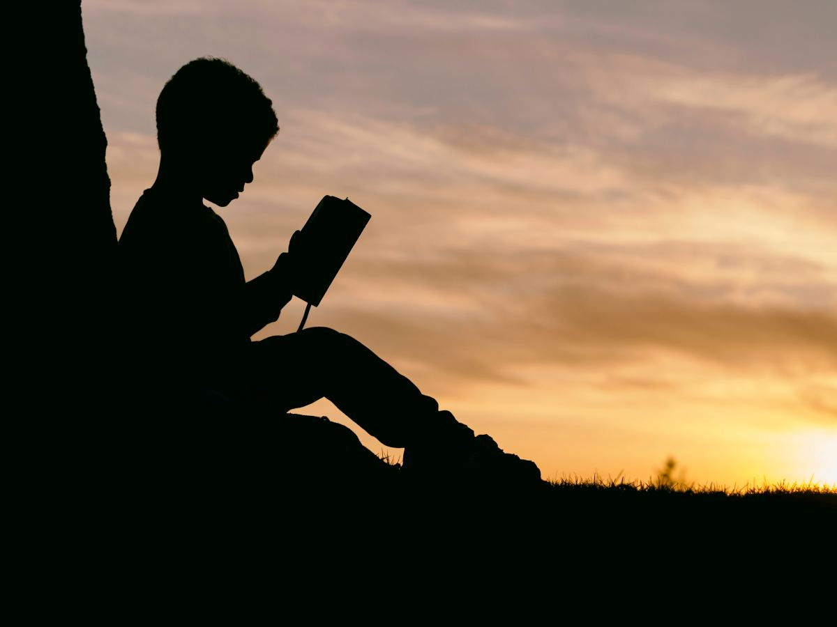 Child reading outdoors nature climate change poetry