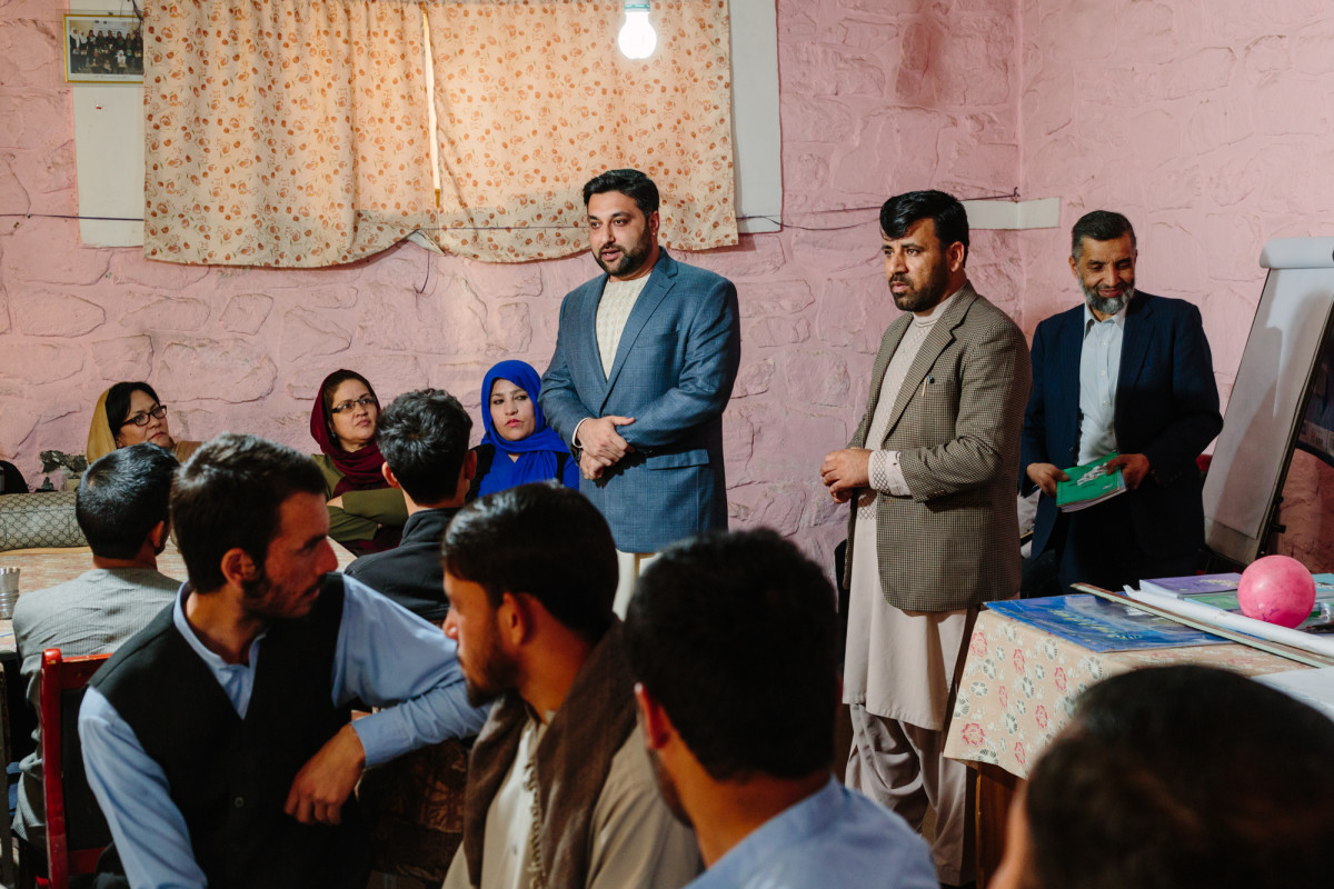 Nasib speaks with students and teachers at a youth organization in Kabul.
