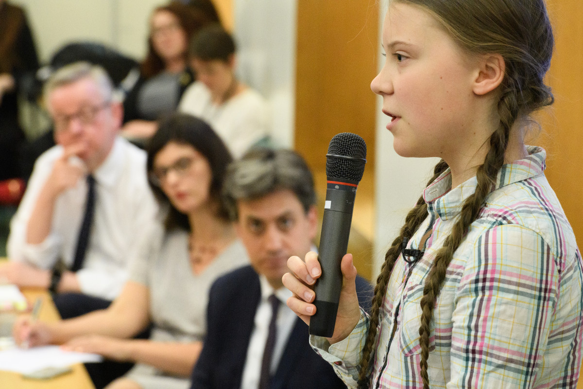 Swedish environmental campaigner Greta Thunberg addresses politicians, media, and guests with the Houses of Parliament on April 23rd, 2019, in London, England. Thunberg criticized the United Kingdom's support of fossil fuel development and urged members of Parliament to consider carbon emissions in all their decisions. Her visit coincides with the ongoing 'Extinction Rebellion' protests across London, which have seen days of disruption to roads and transport systems, in a bid to highlight the dangers of climate change.