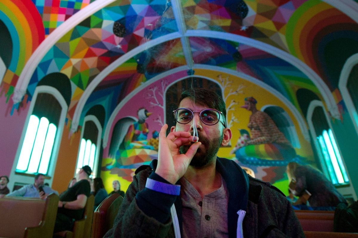 Tushar Mallick of England, a member of the International Church of Cannabis, smokes a joint during a 4/20 celebration on April 20th, 2018, in Denver, Colorado.