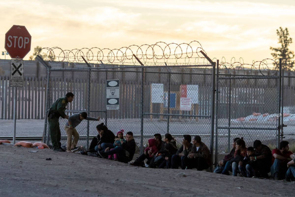 Border Patrol agents are pictured detaining and processing a group of migrants near the Paso Del Norte International Bridge connecting the U.S.–Mexico border cities of El Paso, Texas, and Ciudad Juárez, Chihuahua, on the evening of April 18th, 2019, in El Paso.