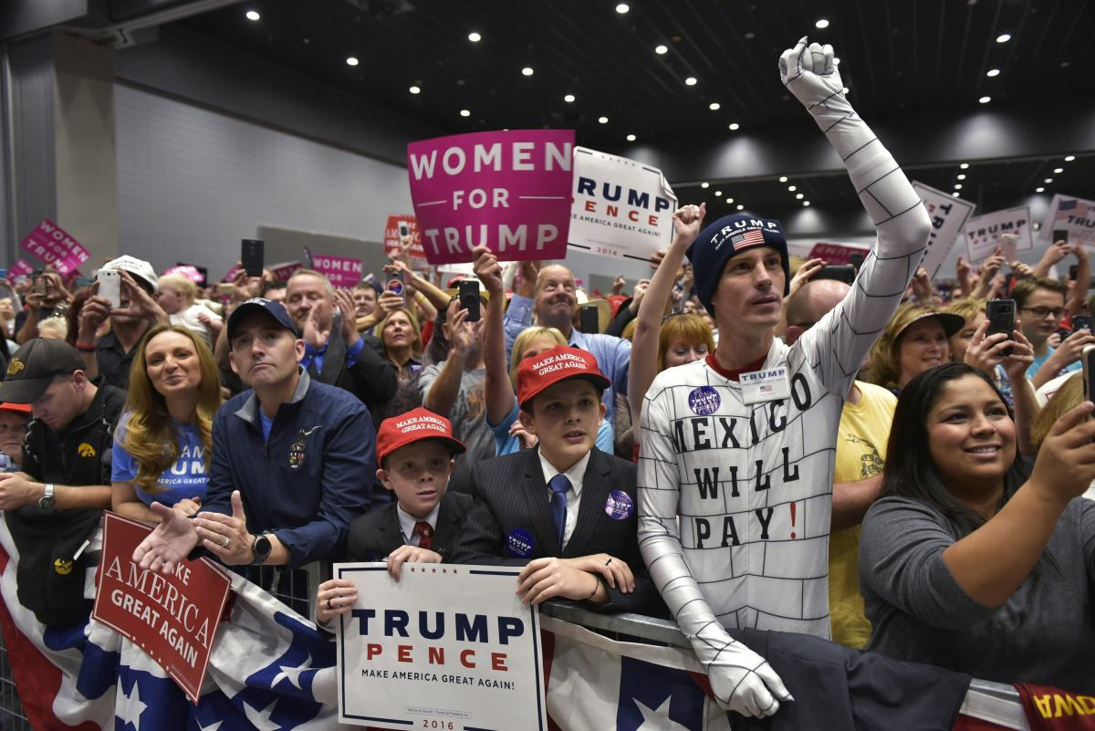 Supporters cheer as then-Republican presidential nominee Donald Trump arrives for a rally at the Sioux City Convention Center in Sioux City, Iowa, on November 6th, 2016.