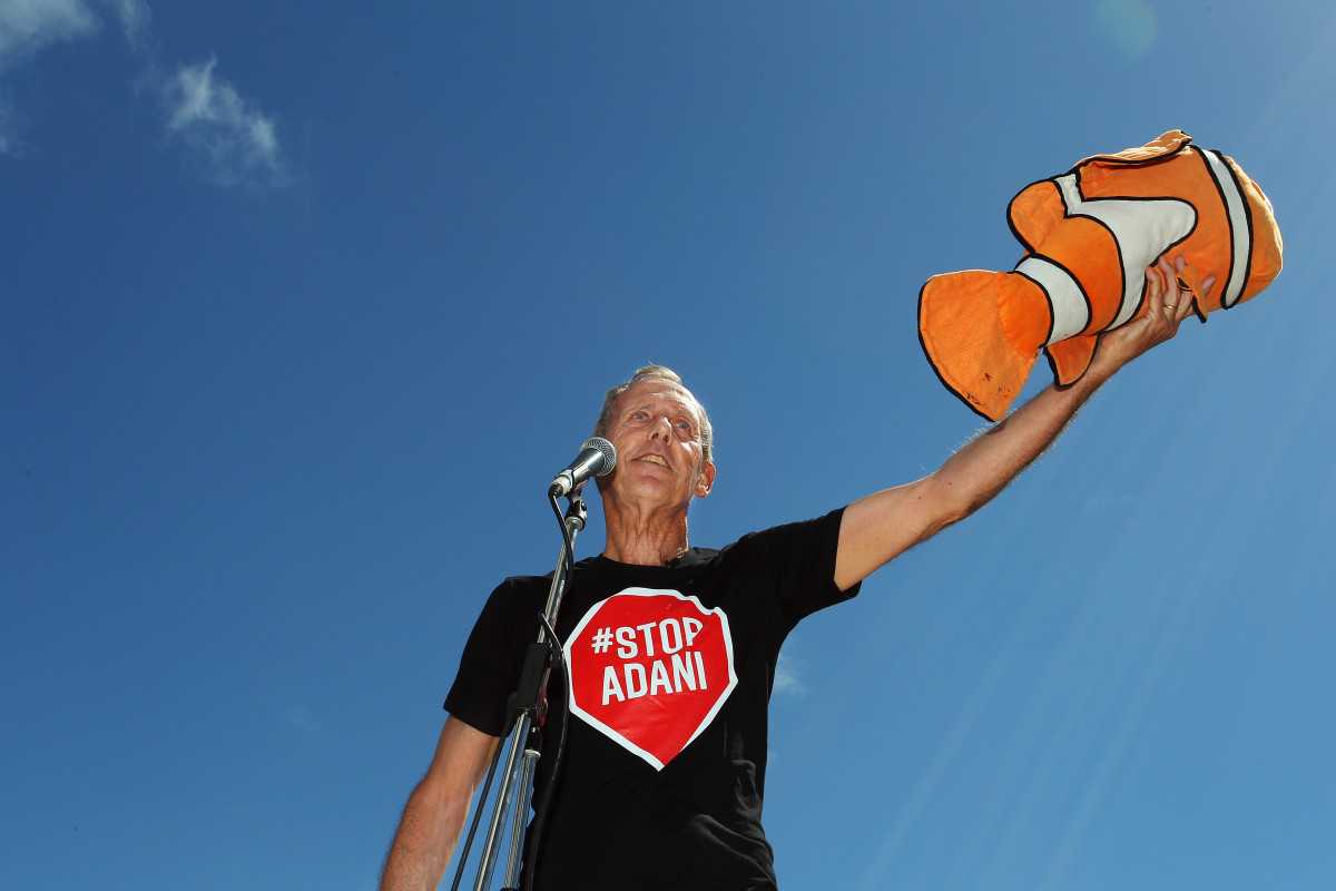 Bob Brown (former Greens leader and conservationist) holds a toy Nemo doll given to him by an audience member as he speaks during an anti-Adani Carmichael coal mine rally on April 26th, 2019, in Airlie Beach, Australia. Bob Brown has been leading a convoy of environmental activists through Australia's southern states toward Central Queensland as part of the #StopAdani movement.