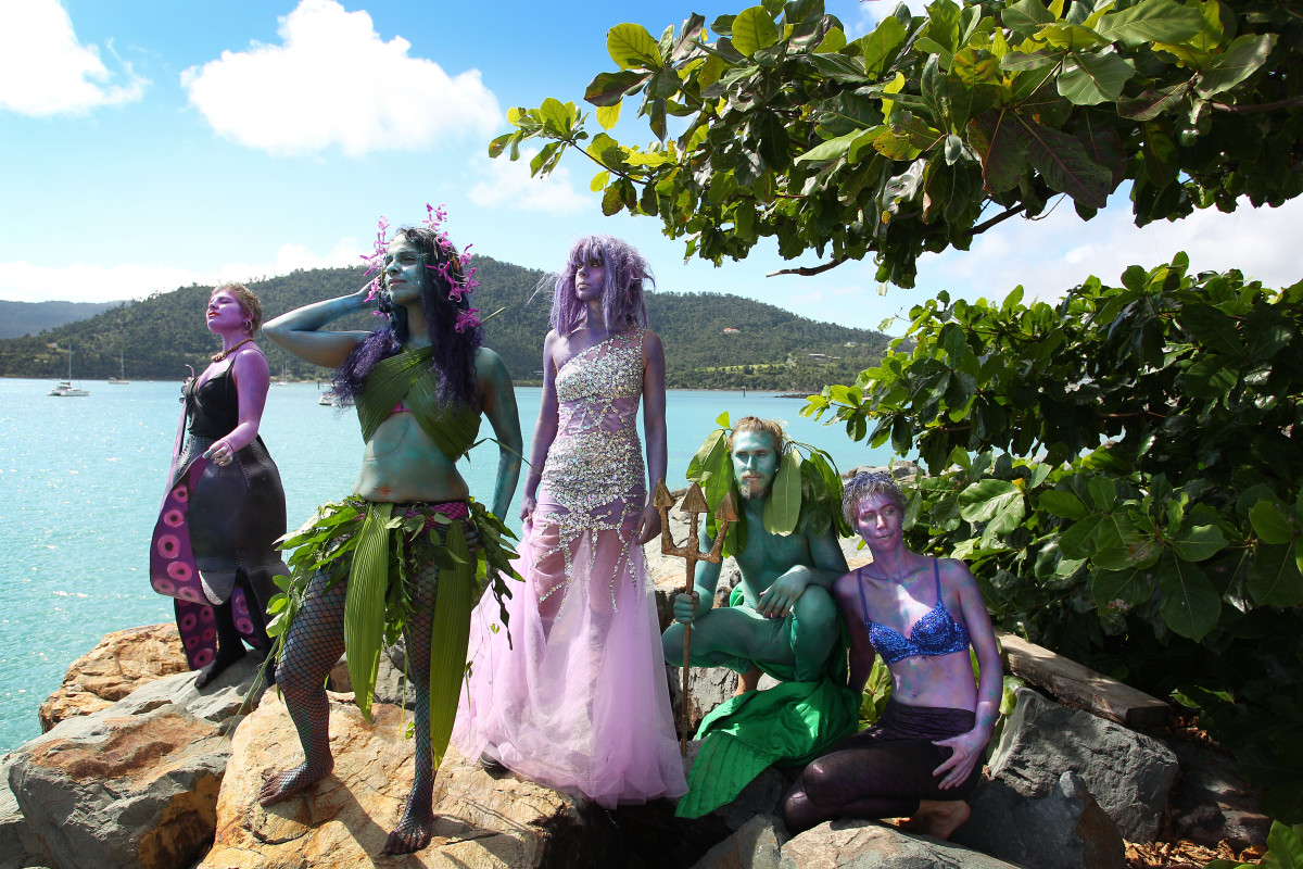 Environment activists dress in costumes and stand at the edge of Airlie Bay during an anti-Adani Carmichael coal mine rally on April 26th, 2019, in Airlie Beach, Australia.