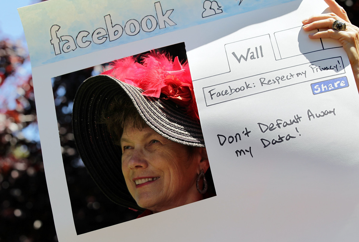 Denely Rafferty of the group Raging Grannies protests outside of Facebook headquarters in June of 2010.