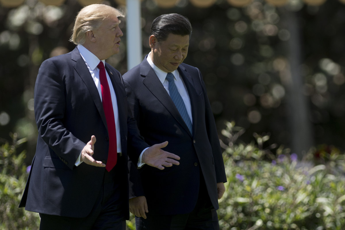 President Donald Trump and Chinese President Xi Jinping walk together at the Mar-a-Lago estate in West Palm Beach, Florida, on April 7th, 2017.