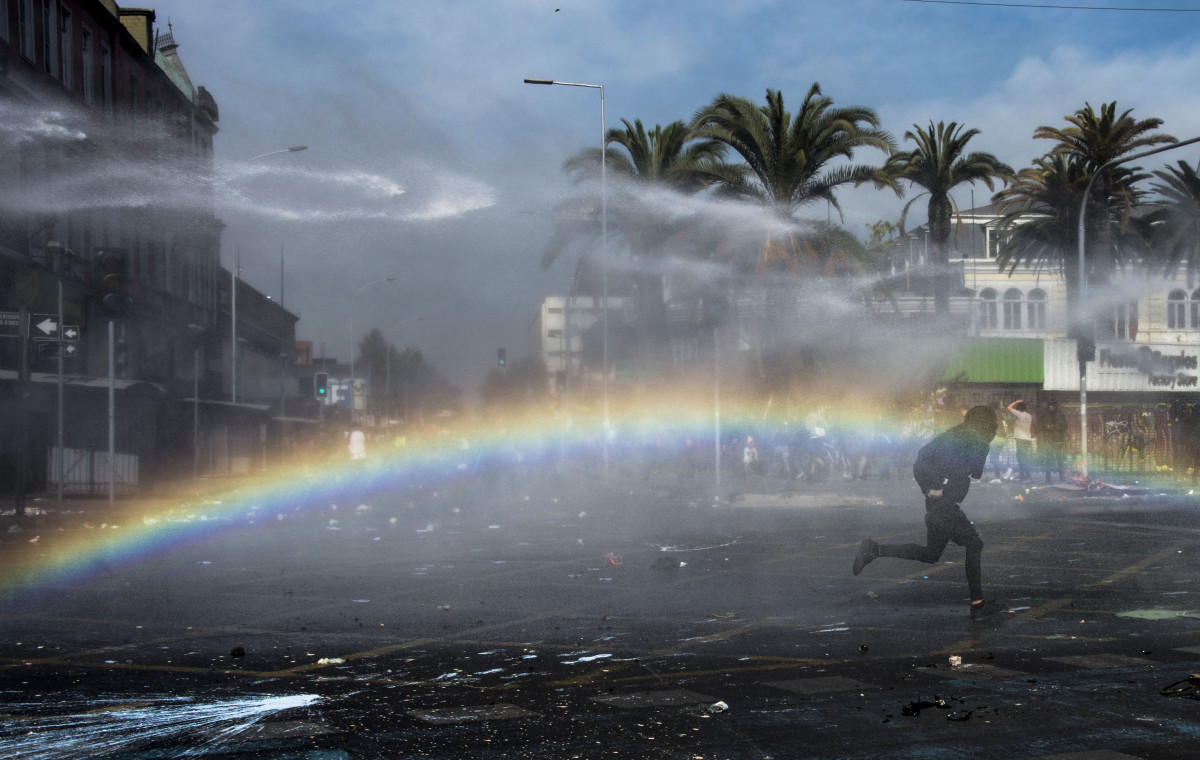A Chilean demonstrator clashes with riot police during a May Day rally in Santiago, Chile, on May 1st, 2019.