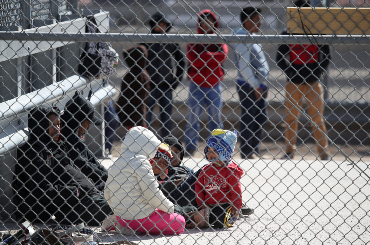 Detained migrants wait to be transported by U.S. Border Patrol at the border of the United States and Mexico on March 31st, 2019, in El Paso, Texas.