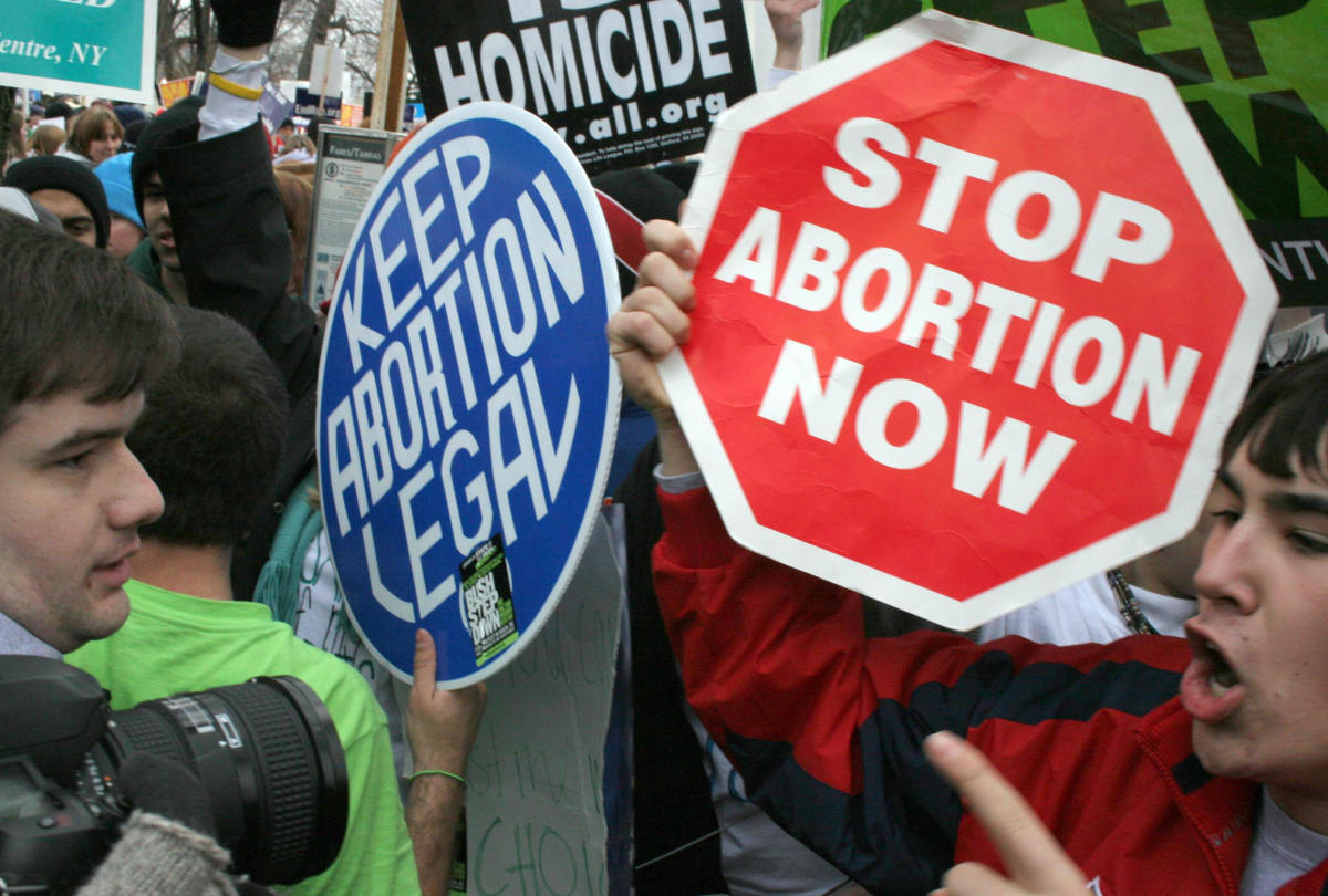 Pro-life demonstrators confront pro-choice counterparts