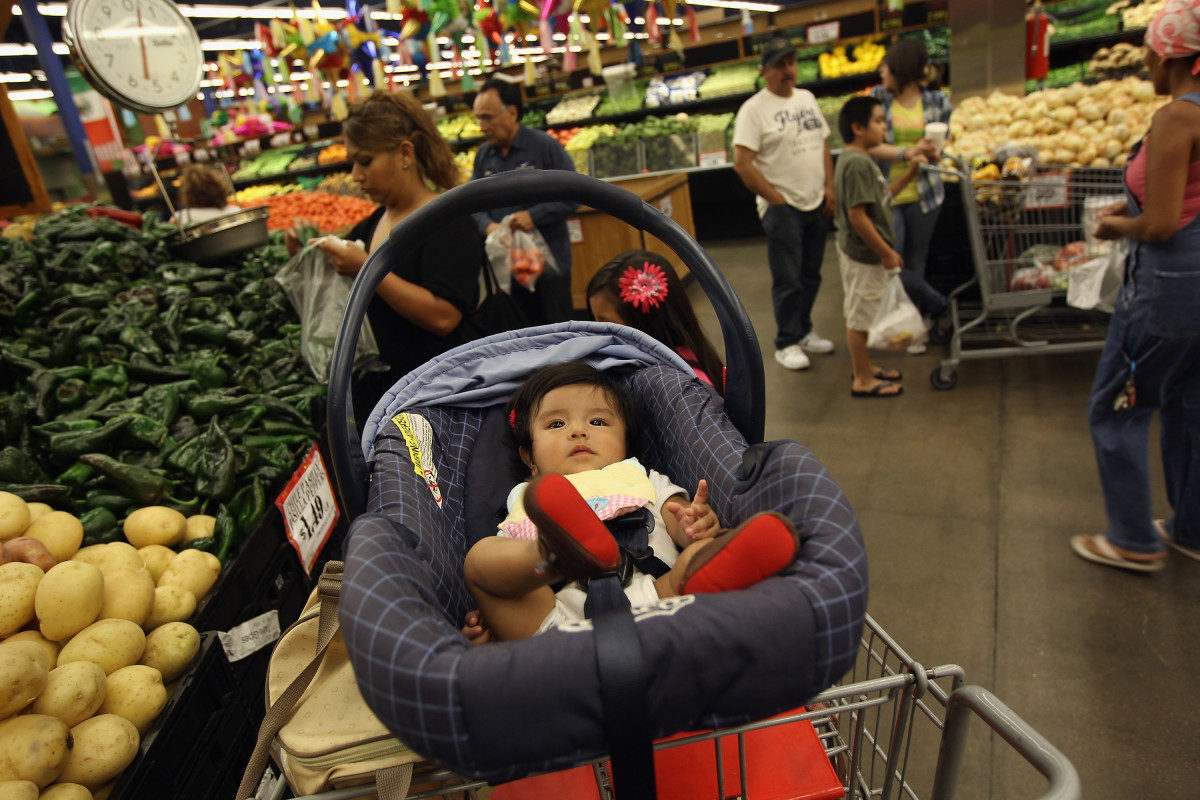 Zury Vizguerra, at age five months, waits while her mother, an undocumented immigrant from Mexico, shops for groceries on July 11th, 2011, in Aurora, Colorado.