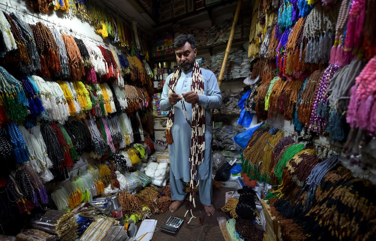 A Pakistani vendor makes prayer rosary beads at his shop in Peshawar, Pakistan, on May 6th, 2019, ahead of the start of Ramadan.