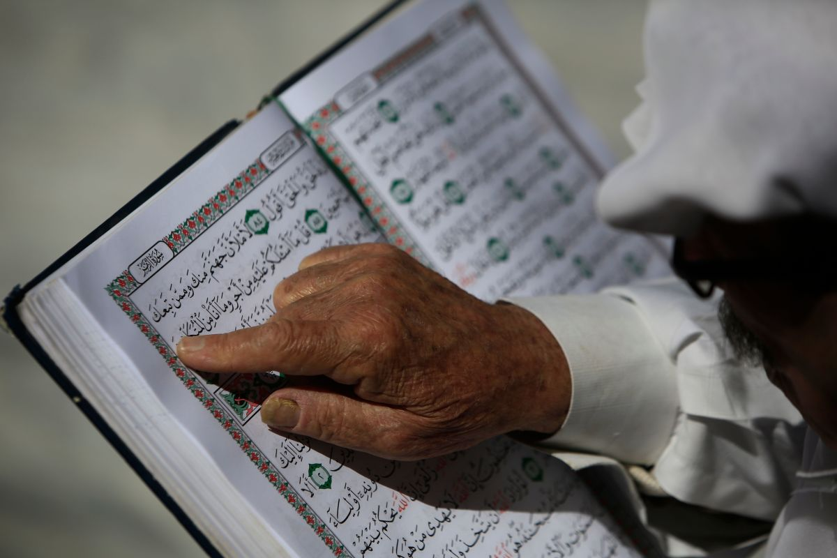 A Palestinian man reads the Quran at the al-Omari mosque in Gaza City, on the second day of Ramadan on May 7th, 2019.
