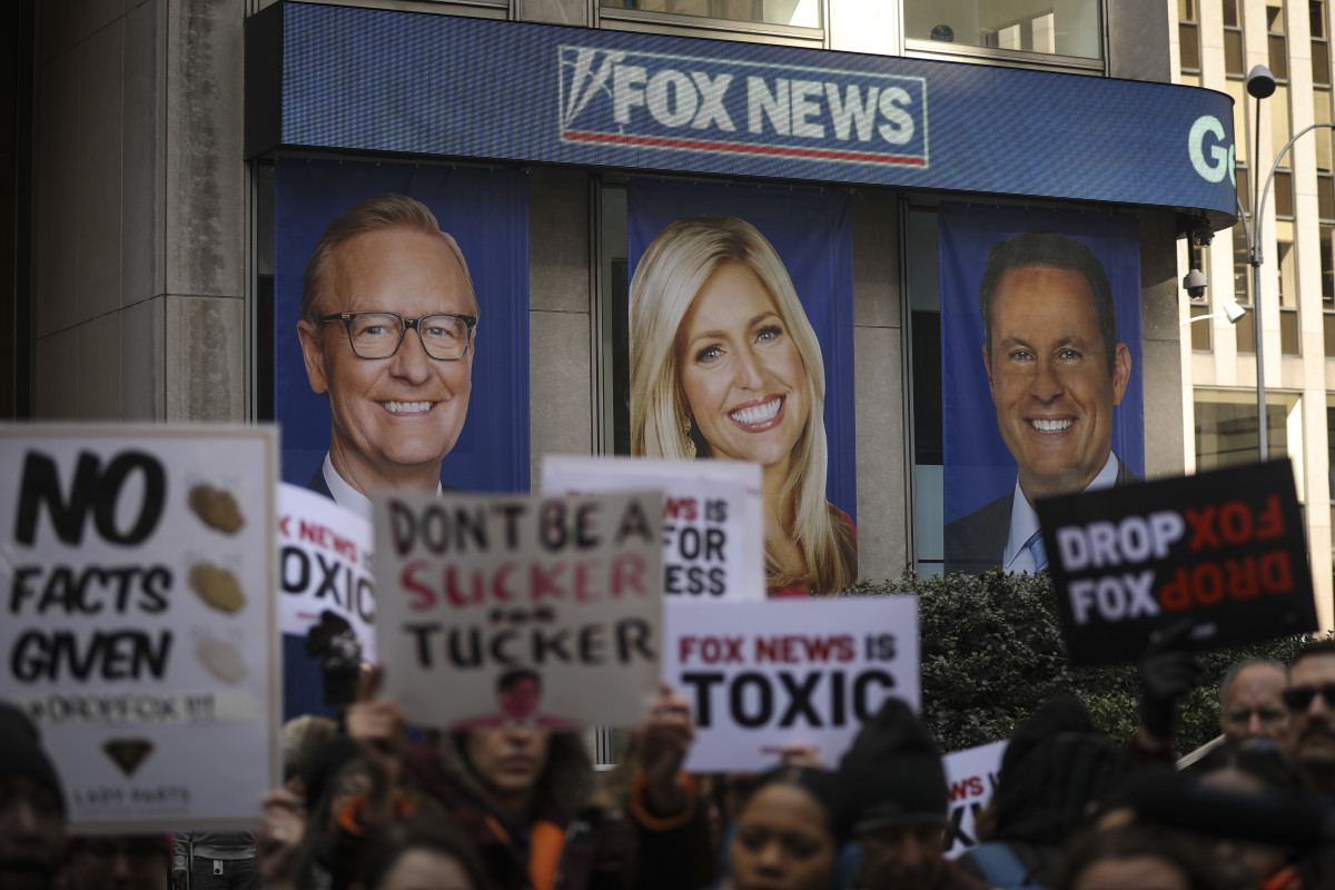 People protesting against Fox News outside the company's headquarters in New York City on March 13th, 2019. Fox News personalities Tucker Carlson and Jeanine Pirro have come under criticism in recent weeks for controversial comments and multiple advertisers have pulled away from their shows.